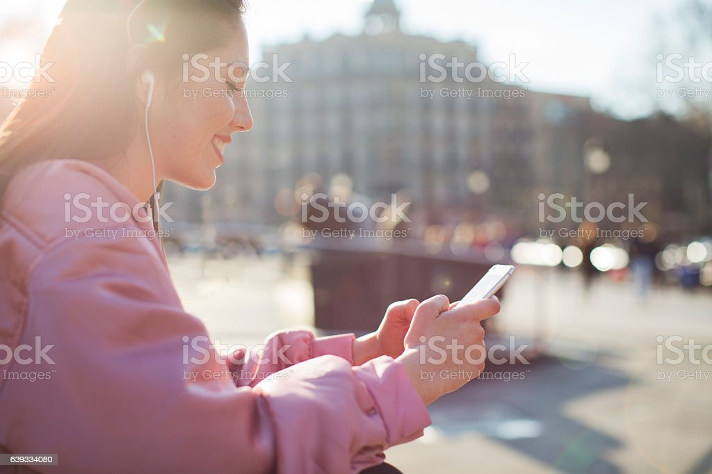 Young beautiful spanish woman in the streets of Barcelona. stock photo