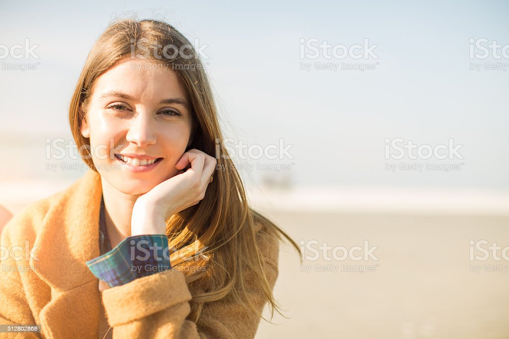 Young beautiful spanish woman smiling at camera. stock photo