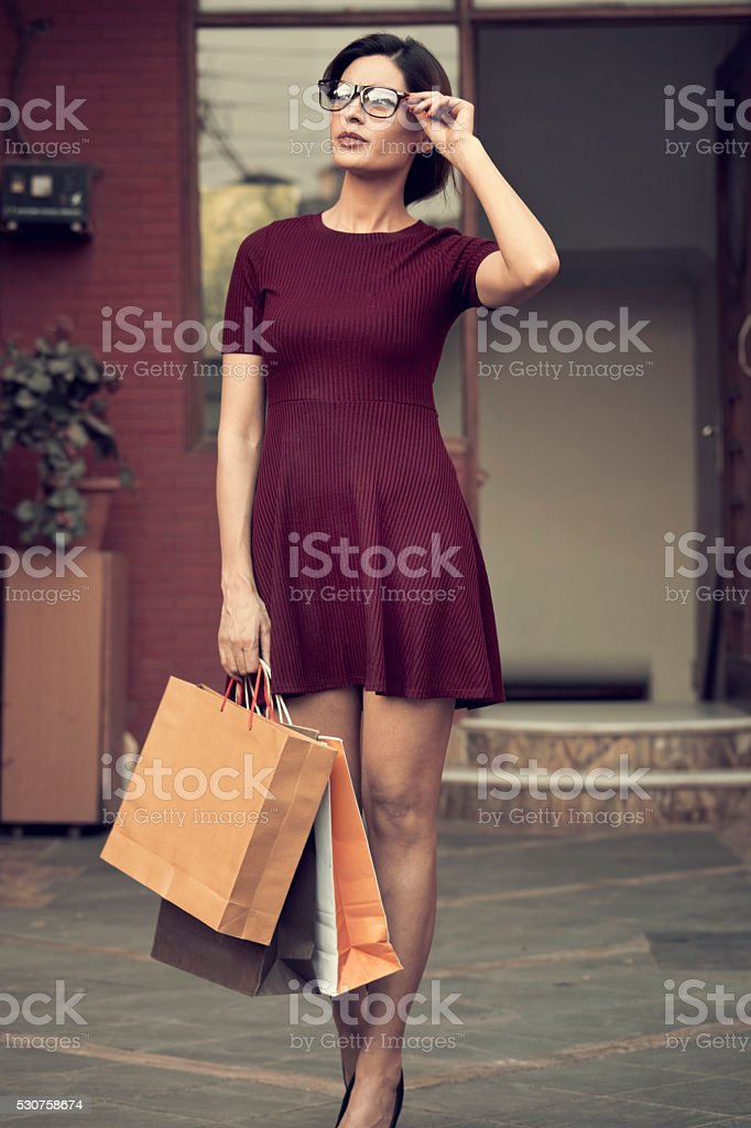 Young beautiful standing with shopping bags stock photo