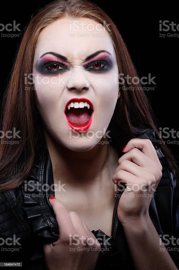 Young beautiful vampire woman stock photo