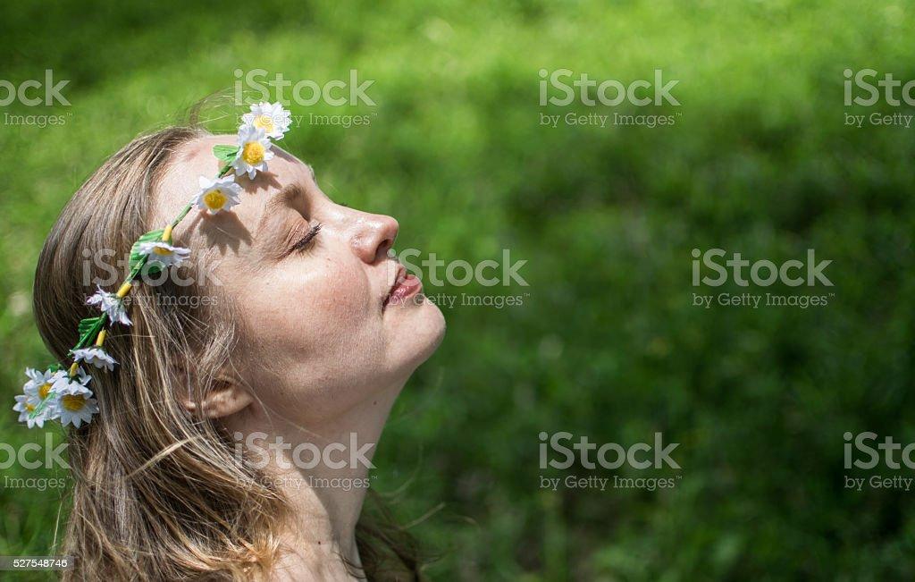 Young Beautiful White Scandinavian Girl Wearing Flowers In Her Hair stock photo