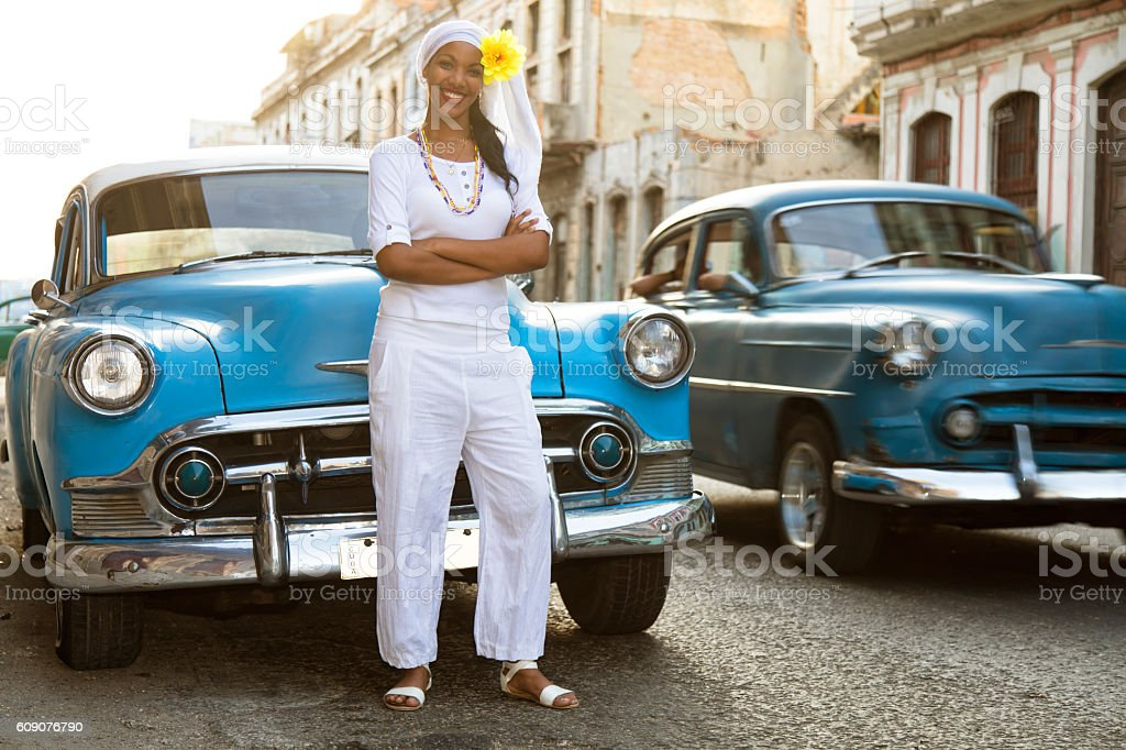 Young, Beautiful Woman and Vintage Cars, Havana, Cuba stock photo
