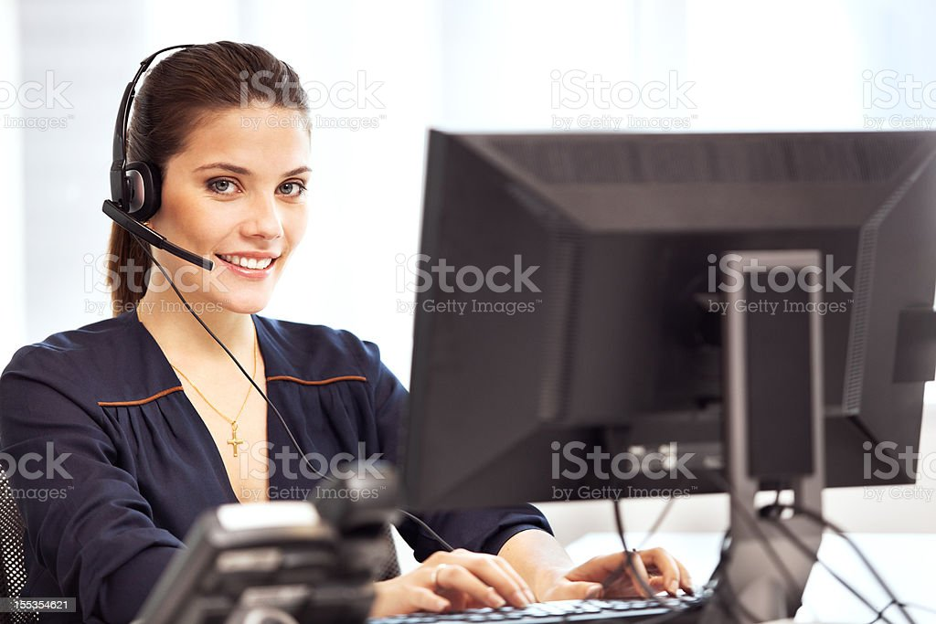 Young beautiful woman at her workplace in the office. royalty-free stock photo
