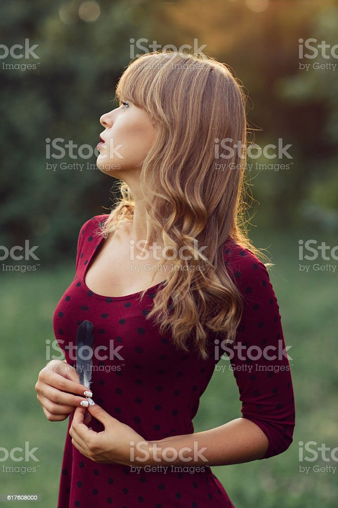 Young beautiful woman at nature stock photo