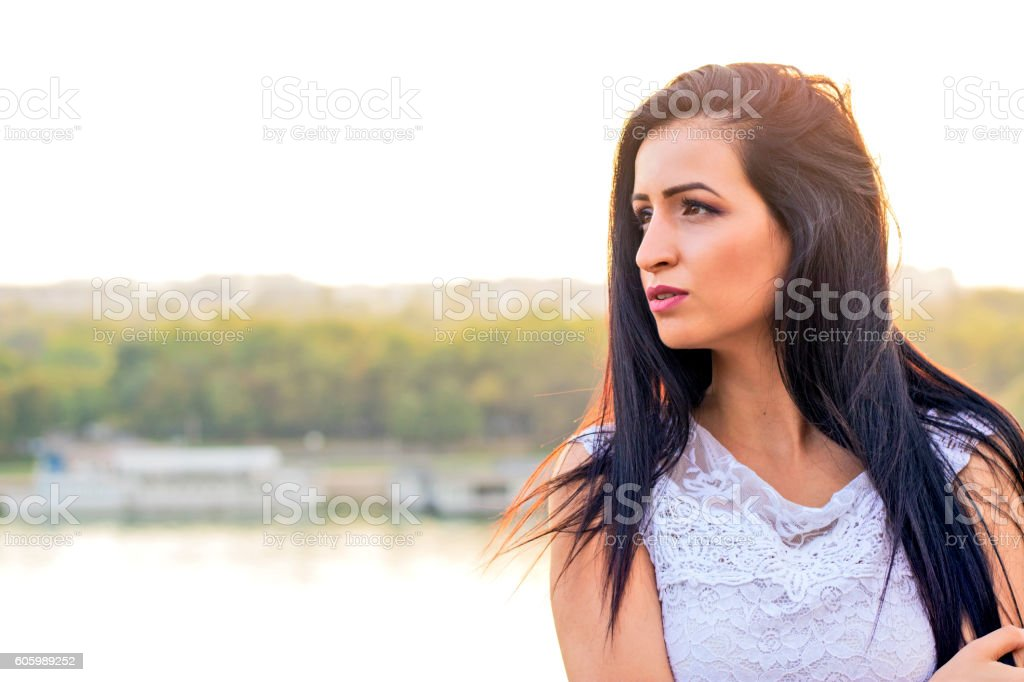 Young beautiful woman at the park stock photo