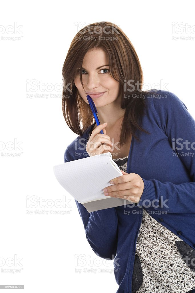 Young beautiful woman does records by pen in notepad royalty-free stock photo