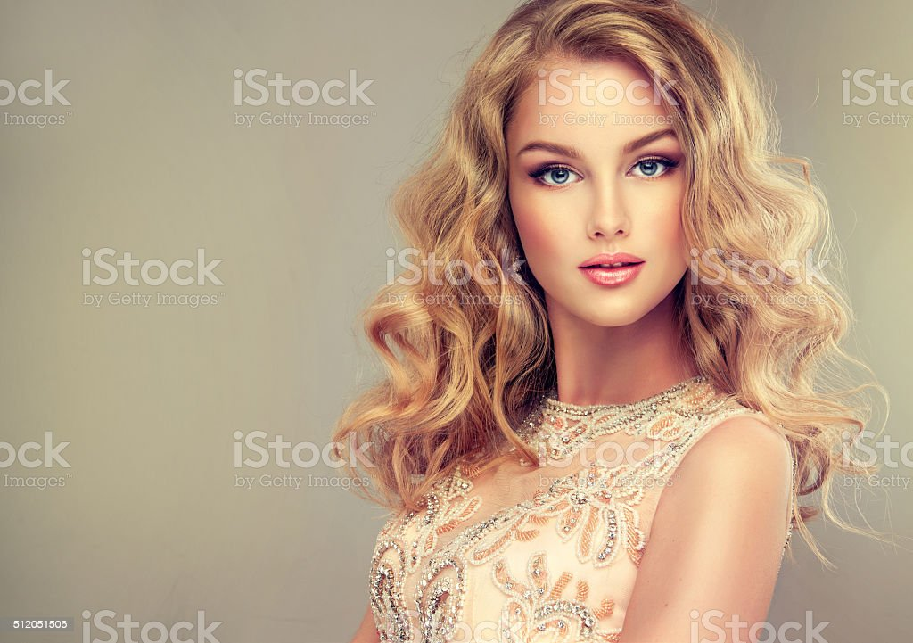 Young beautiful woman, dressed in evening gown. stock photo