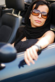 Young beautiful woman driving a car