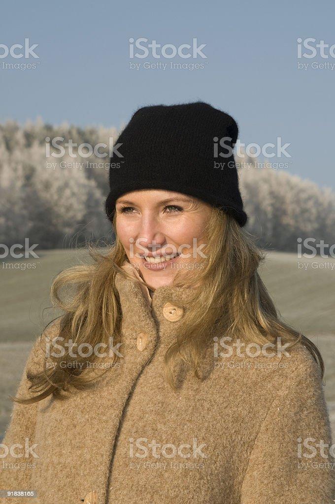 Young beautiful woman enjoy the winter stock photo
