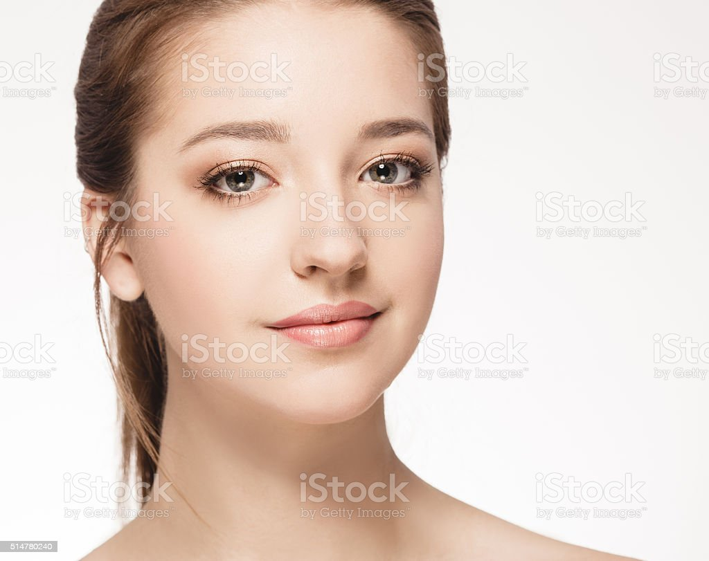 Young beautiful woman face portrait with healthy skin stock photo