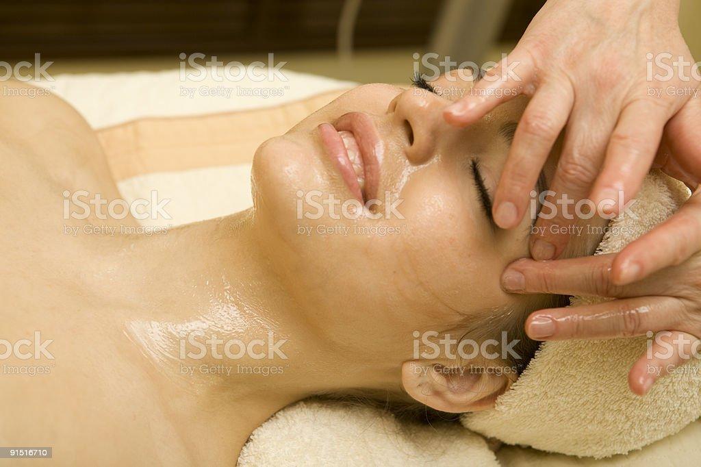 Young beautiful woman having facial massage.XXXL royalty-free stock photo