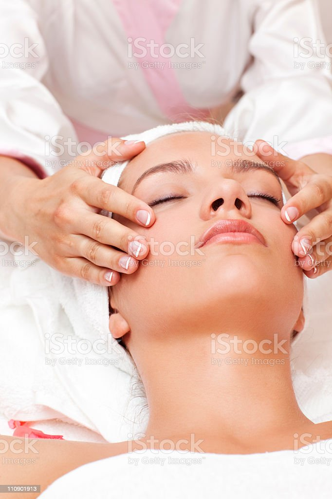 Young beautiful woman having facial treatment royalty-free stock photo