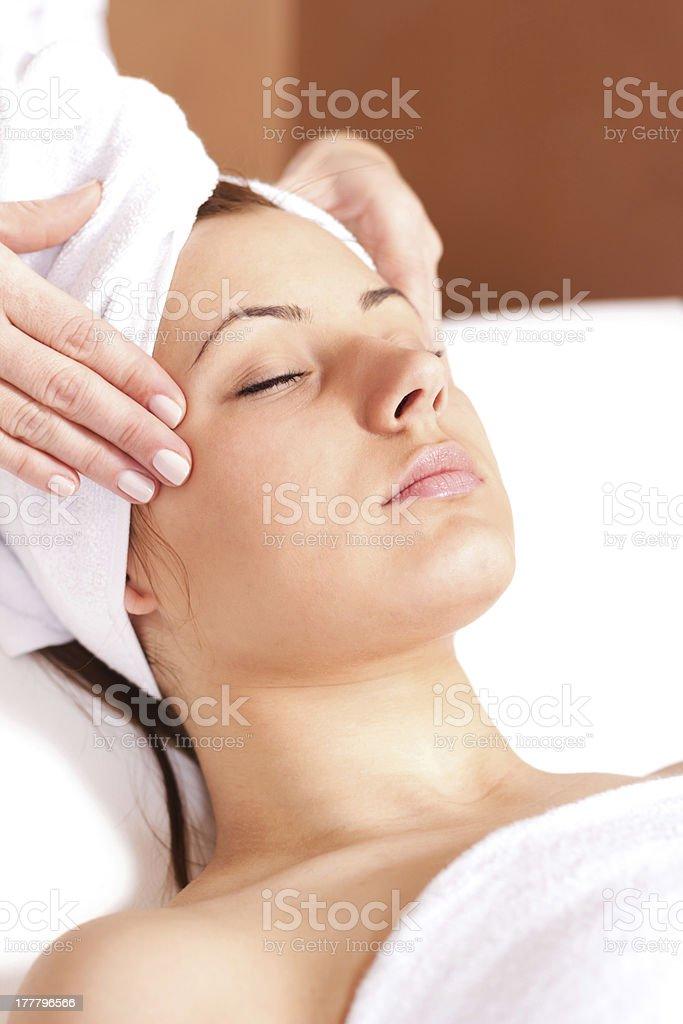 Young beautiful woman having facial treatment royalty-free stock photo