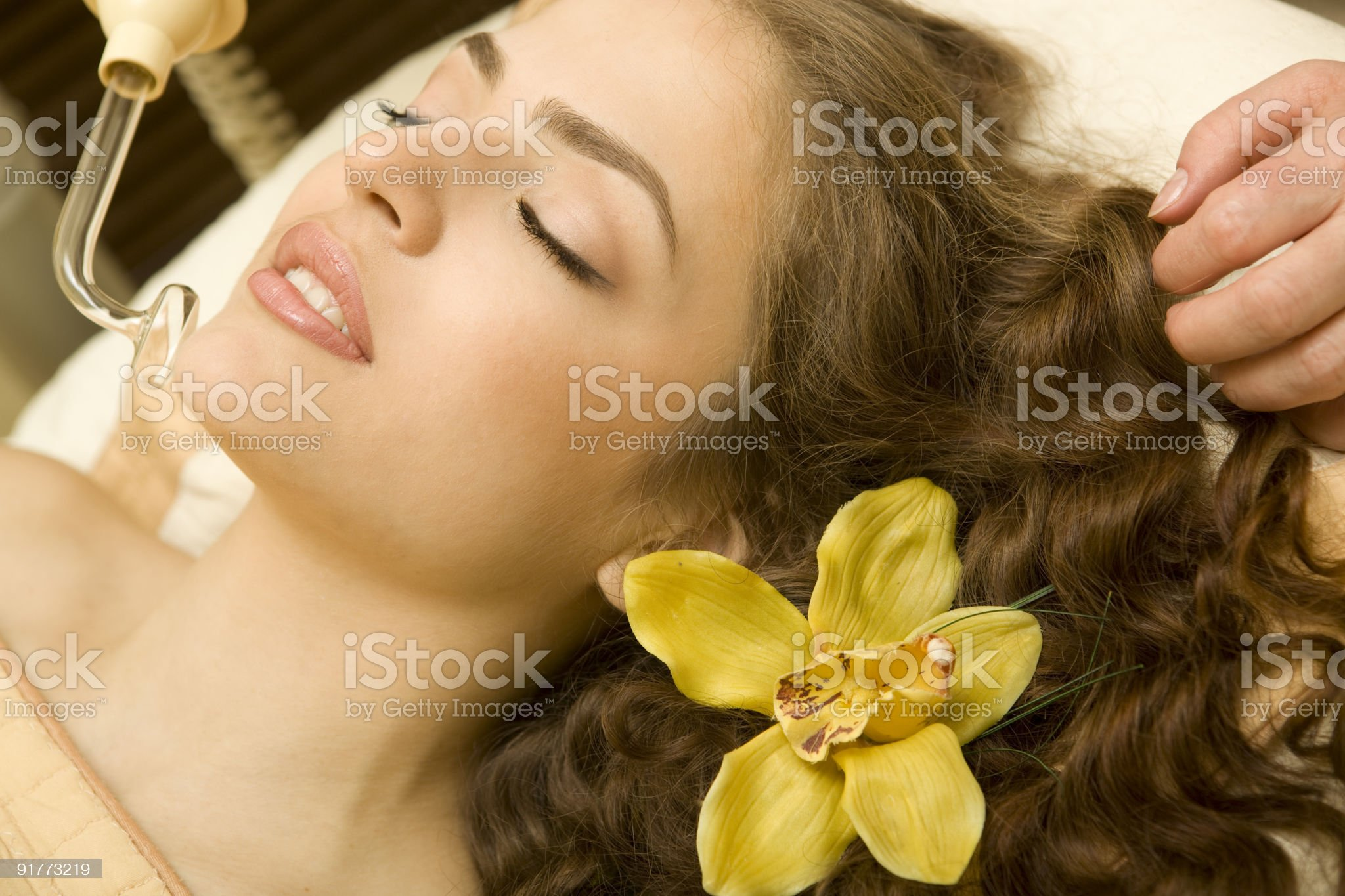 Young beautiful woman having facial treatment.XXXL royalty-free stock photo