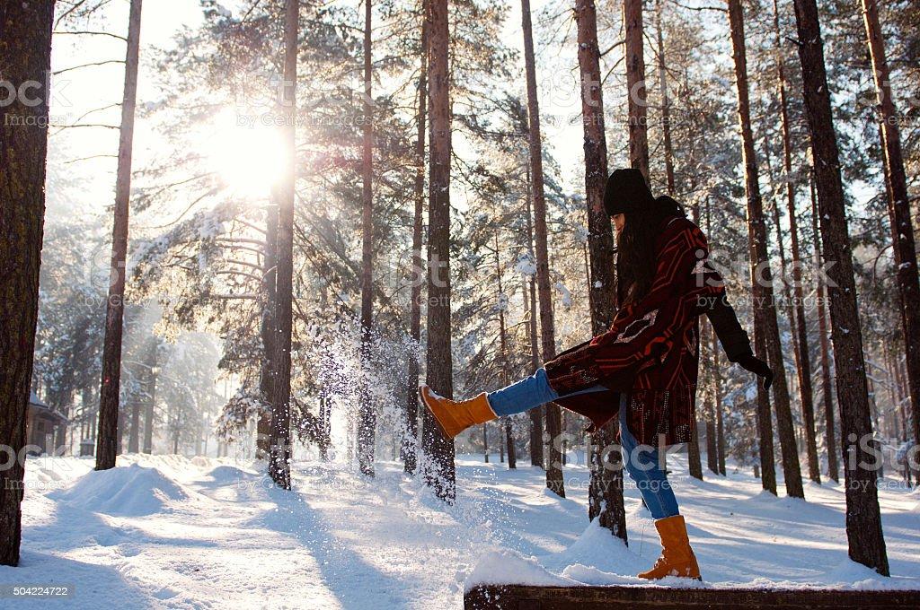 Young beautiful woman having fun in winter stock photo
