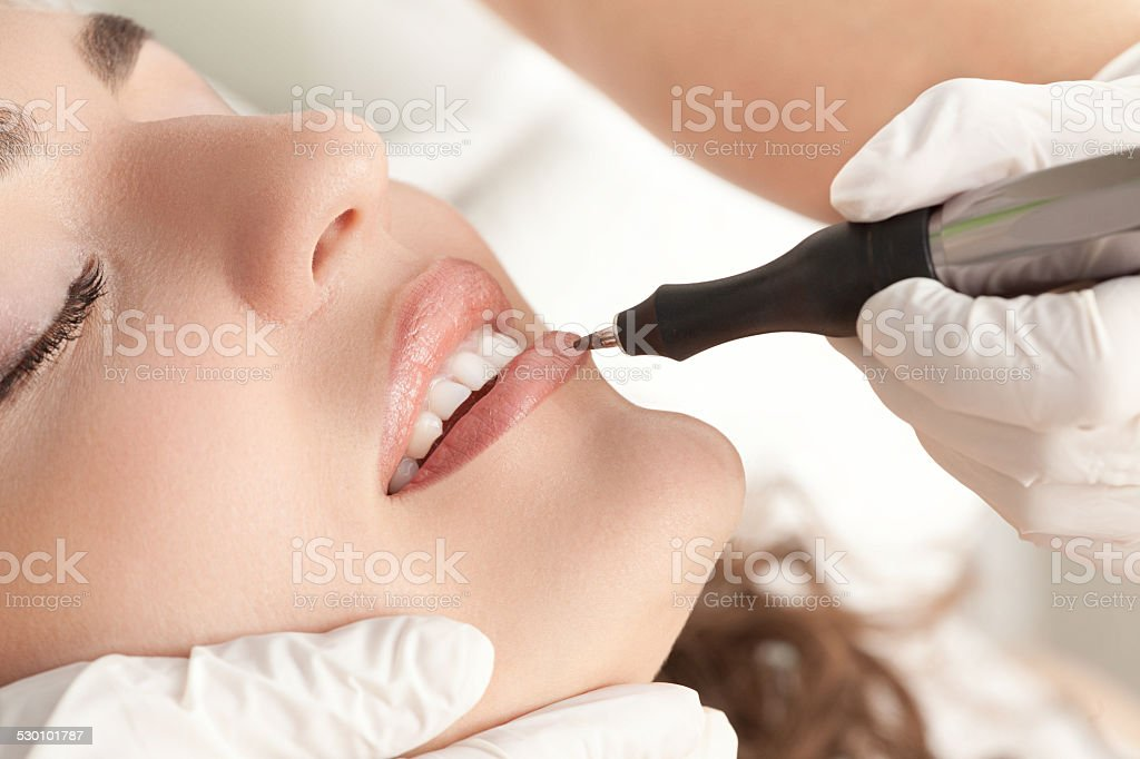 Young Beautiful  Woman Having Permanent Make-up (Tattoo) stock photo