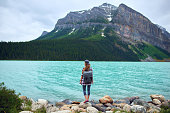 Young beautiful woman hiking near the lake