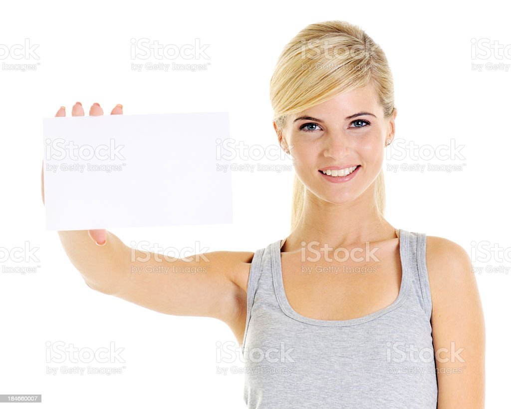 Young beautiful woman holding a business card royalty-free stock photo
