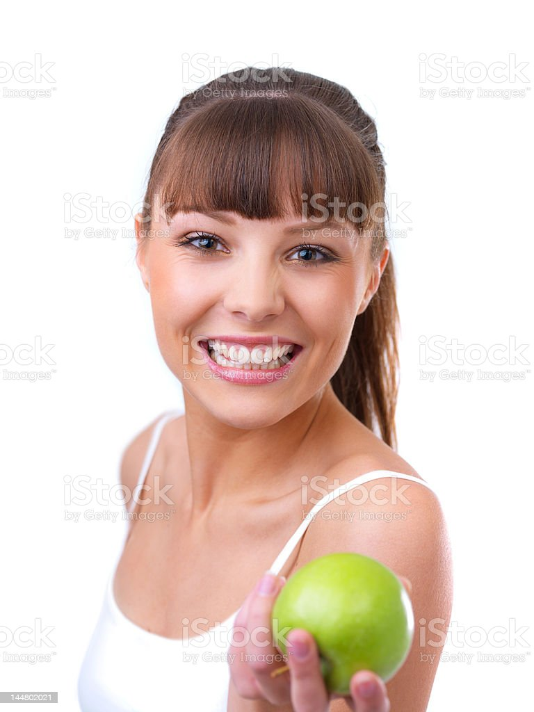 Young beautiful woman holding an apple royalty-free stock photo
