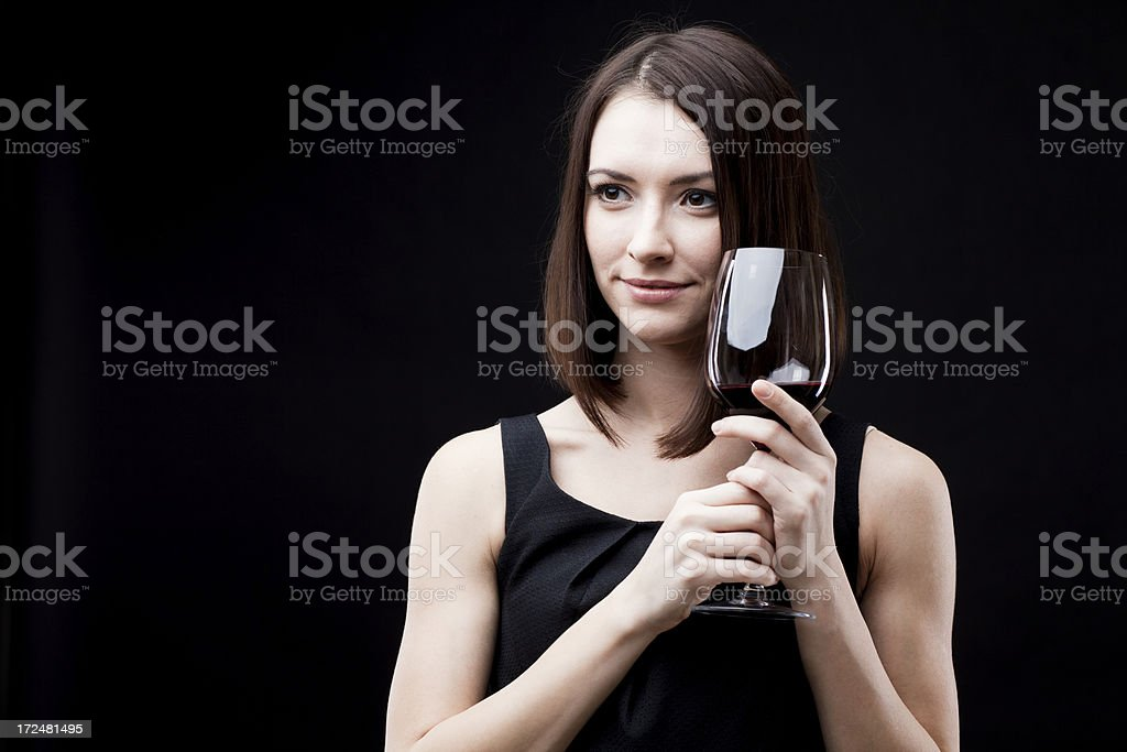 young beautiful woman holding glass of red wine royalty-free stock photo