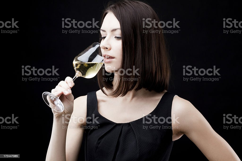 young beautiful woman holding glass of white wine royalty-free stock photo