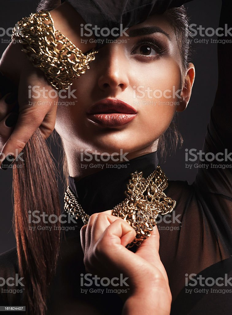 Young beautiful woman in a necklace and bracelet royalty-free stock photo