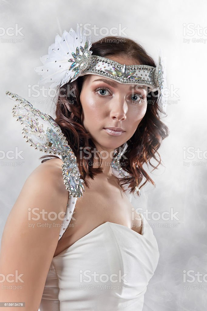 Young beautiful woman in angel costume stock photo