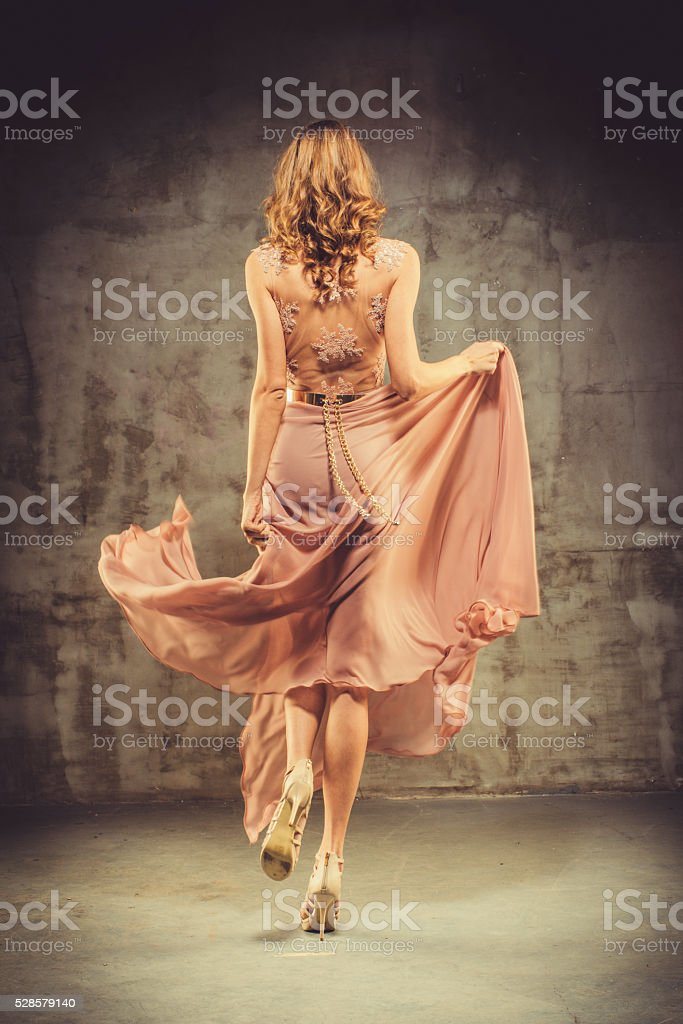 Young Beautiful Woman In Evening Dress stock photo