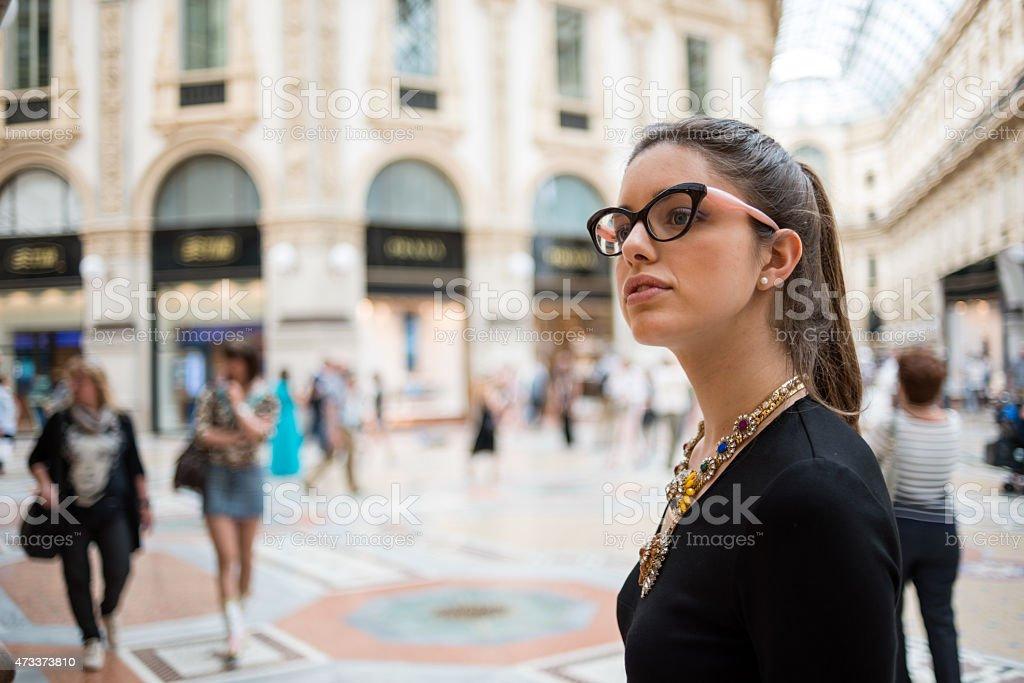 Young beautiful woman in Galleria Vittorio Emanuele, Milan stock photo