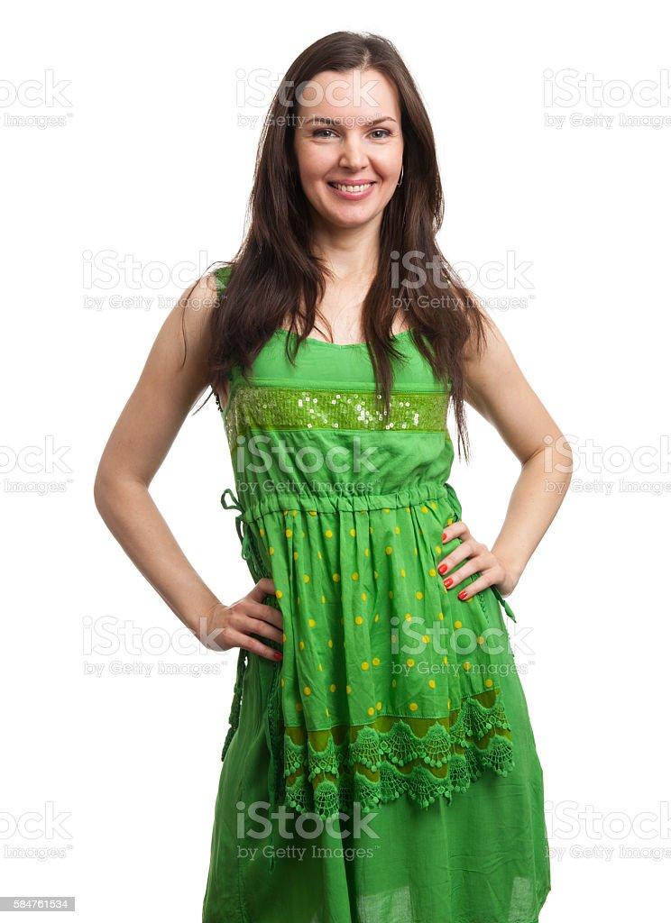young beautiful woman in green dress smiling stock photo
