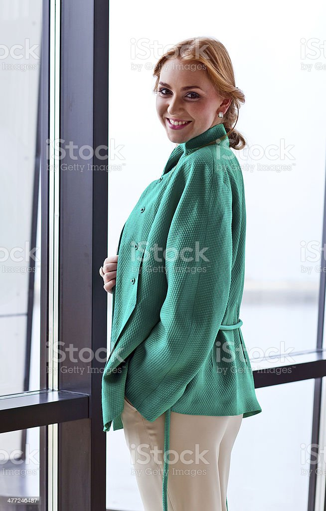 young beautiful woman in green jacket royalty-free stock photo