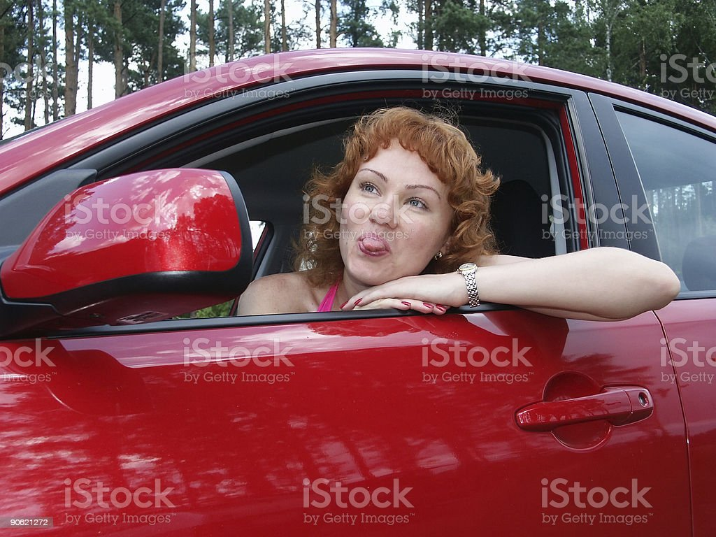 young beautiful woman in red car royalty-free stock photo