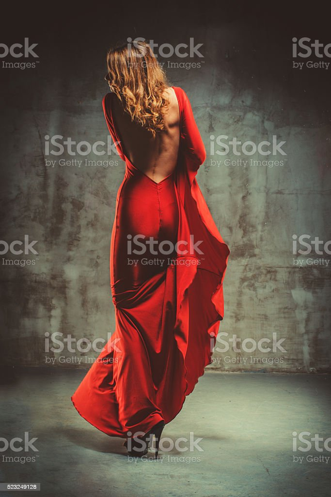 Young Beautiful Woman In Red Dress stock photo