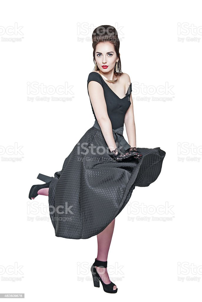 Young beautiful woman in retro pin-up style with fluttering dres stock photo