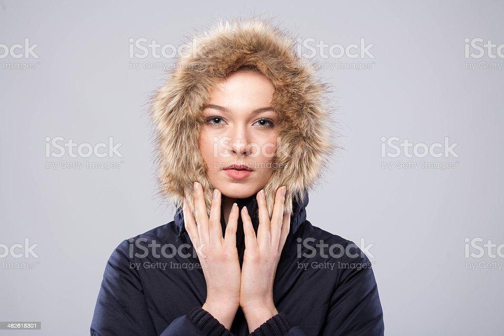 Young beautiful woman in winter clothes stock photo