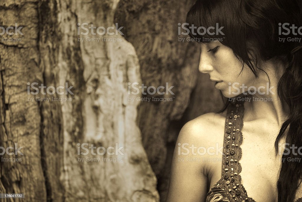 Young beautiful woman inside of a tree royalty-free stock photo