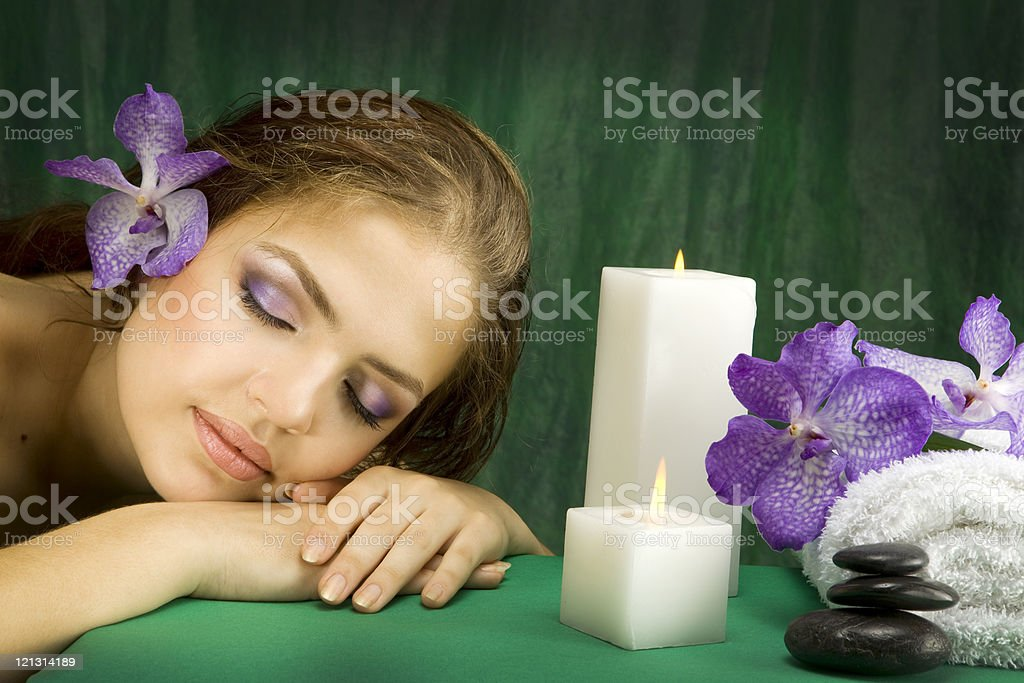Young beautiful woman lying down with orchids.XXXL royalty-free stock photo