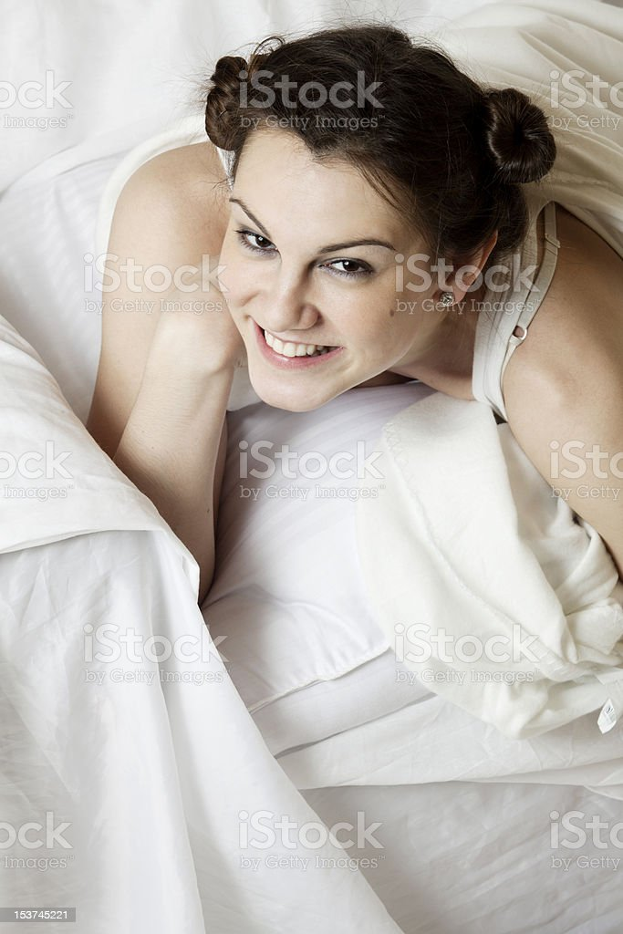 Young beautiful woman lying on the bed stock photo