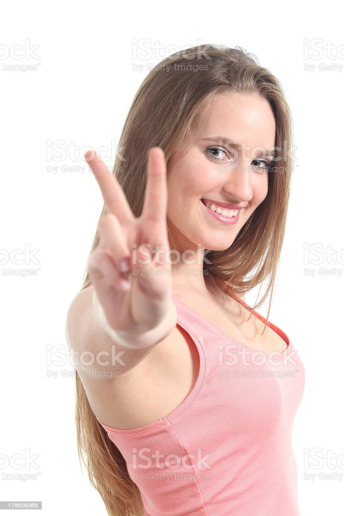 Young beautiful woman making the victory or peace gesture royalty-free stock photo