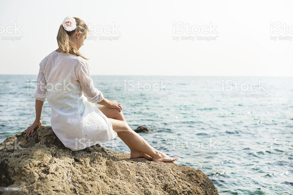 Young beautiful woman near the sea royalty-free stock photo
