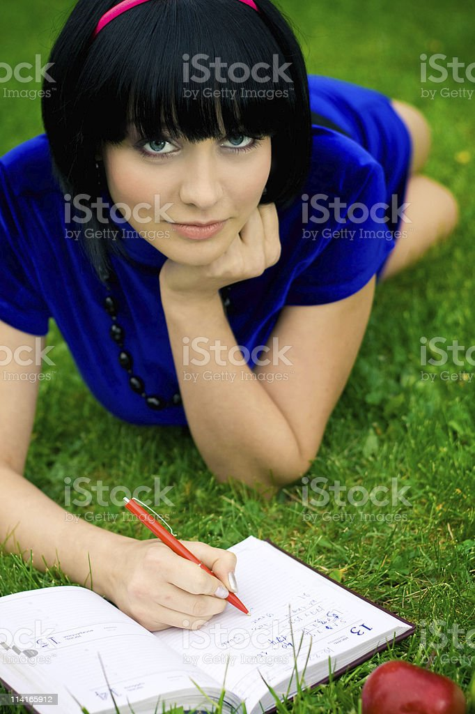 Young beautiful woman on green field royalty-free stock photo