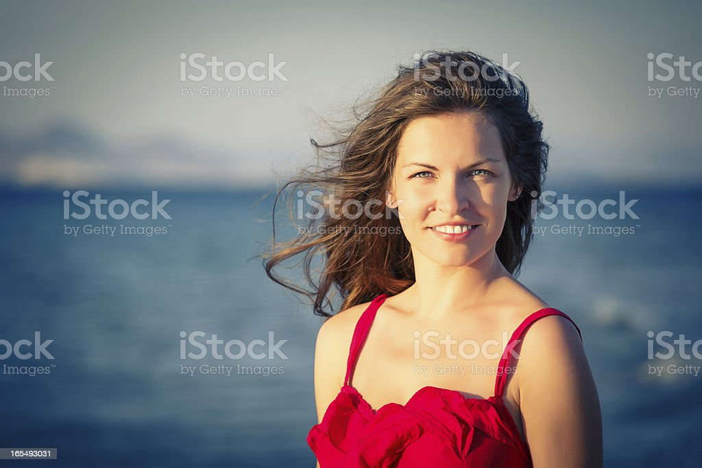 Young beautiful woman on the beach royalty-free stock photo