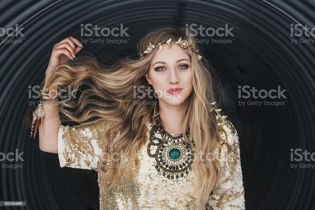 Young beautiful woman outdoors contemporary style stock photo