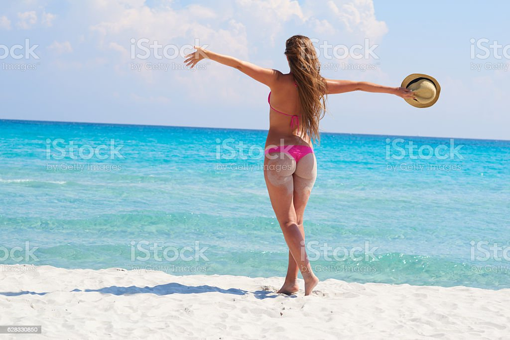 Young beautiful woman over sea background stock photo
