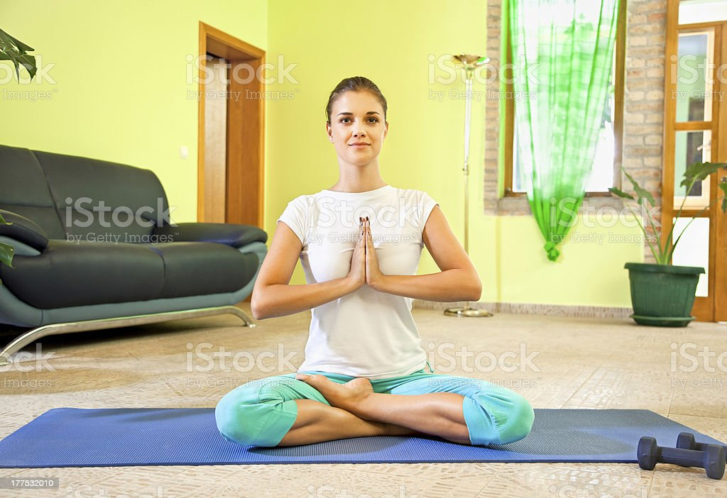 Young beautiful woman preparing for meditation royalty-free stock photo