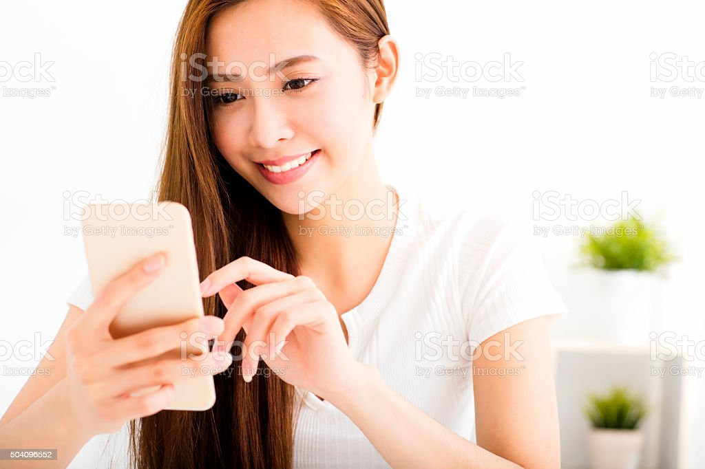 young beautiful woman reading message with smart phone stock photo