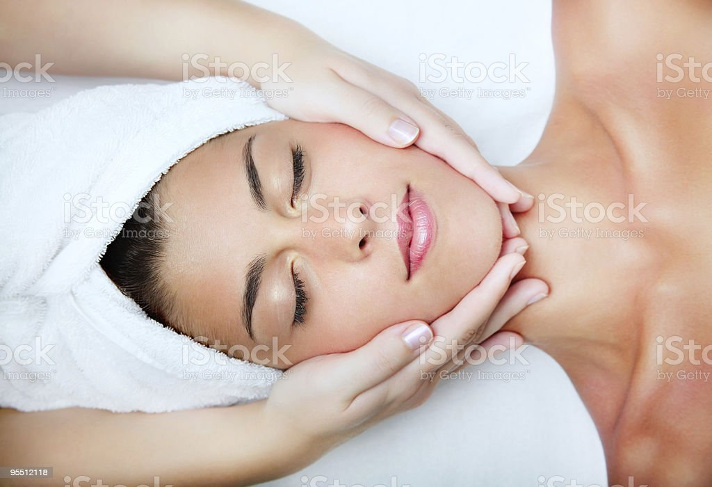 Young beautiful woman receiving facial massage royalty-free stock photo