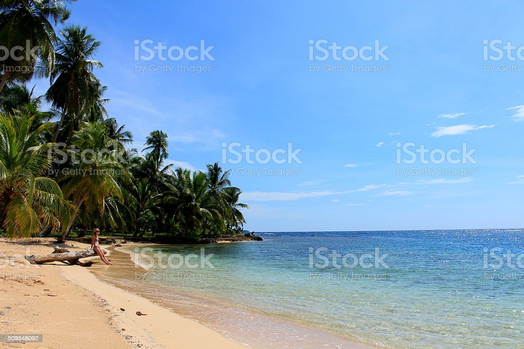 Young beautiful woman resting close to the sea stock photo