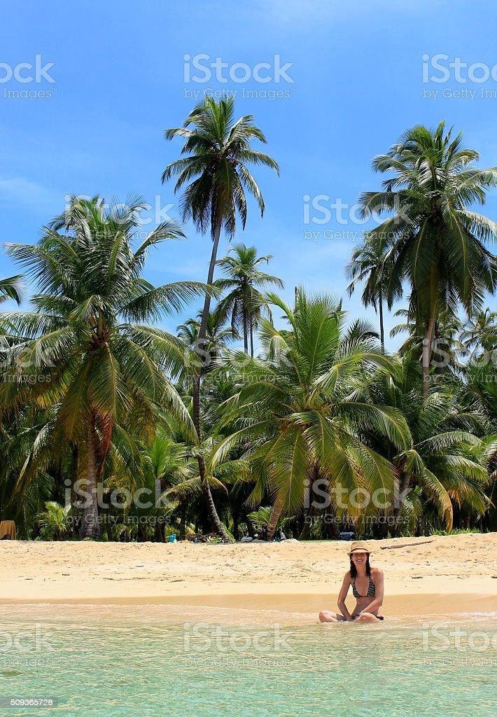Young beautiful woman resting in Pelicano beach, Panama. stock photo