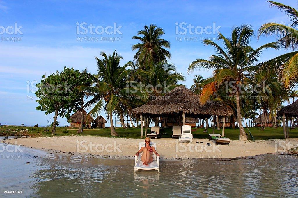 Young beautiful woman resting in Yandup lodge's private beach, Panama. stock photo